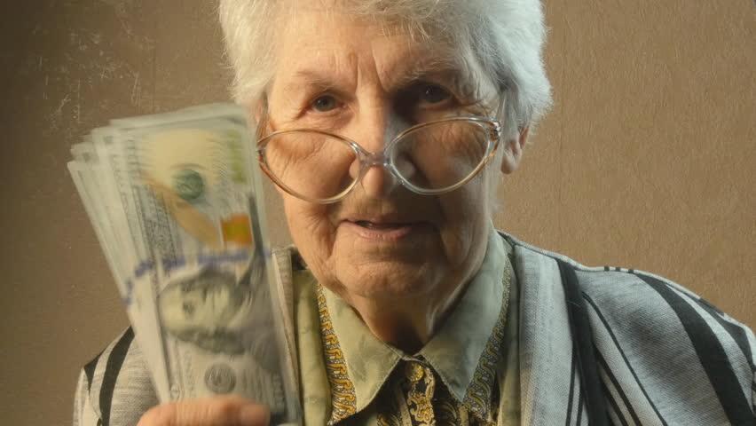 Old woman rejoices money