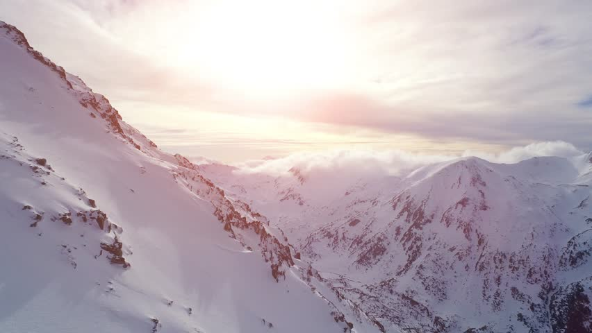 Beautiful Winter Nature Aerial Footage Of Sunset In The Mountains Sunrise Shining Flare Peaks Morning Beauty Travel Vacation Inspiration Landscape Background  UHD 4K