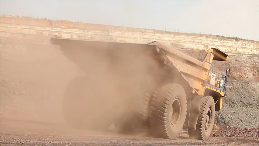 mining trucks in giant open pit mine, heavy mining truck loaded with iron ore on the opencast quarry, Haul truck in a iron mine