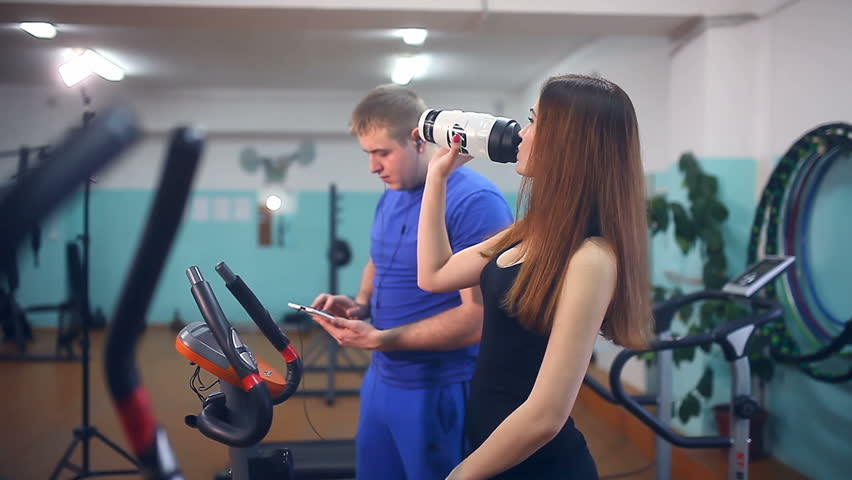 Man male athlete drinking water get tired in gym trainers stock girl athlete drinking water get tired in gym sport trainers hd stock video clip sciox Choice Image