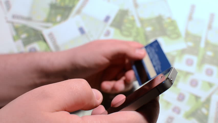 Using Mobile Smartphone Technology And Credit Card and Money   Shutterstock HD Video #15114649