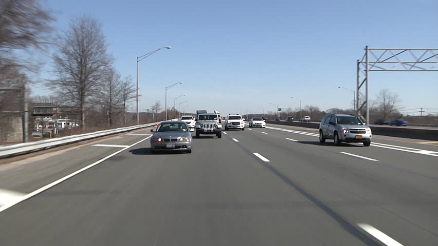 Driving Plate - Rear view from a car on the Long Island Expressway. Three lane highway from New York City to Riverhead. Commuter traffic is backed up due to major congestion and construction projects.