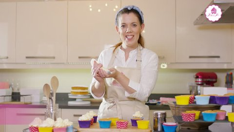 4K TV presenters on a cookery channel making cupcakes & talking to camera