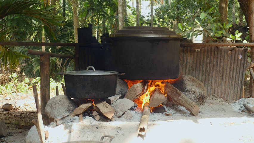 Cooking Pots On Open Wood Burning Stock Footage Video 100 Royalty Free 15145429 Shutterstock