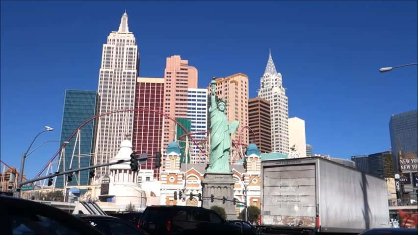 LAS VEGAS, NV- MARCH 10, 2016:  cars driving along Las Vegas strip with casino architecture in background | Shutterstock HD Video #15148279