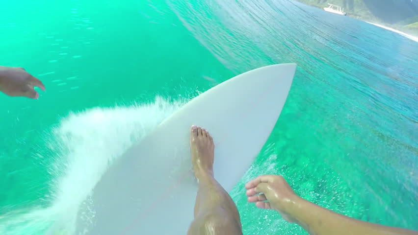 FPV SLOW MOTION: Extreme pro surfer paddling and standing up on surfboard, riding big tube barrel wave Teahupoo in crystal clear Pacific ocean in sunny Tahiti island | Shutterstock HD Video #15149452