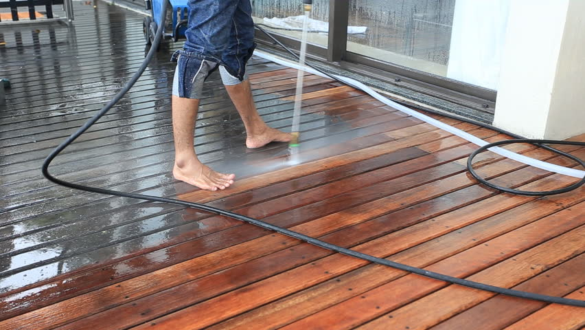 outdoor wood floor cleaning with high pressure water jet hd stock footage clip