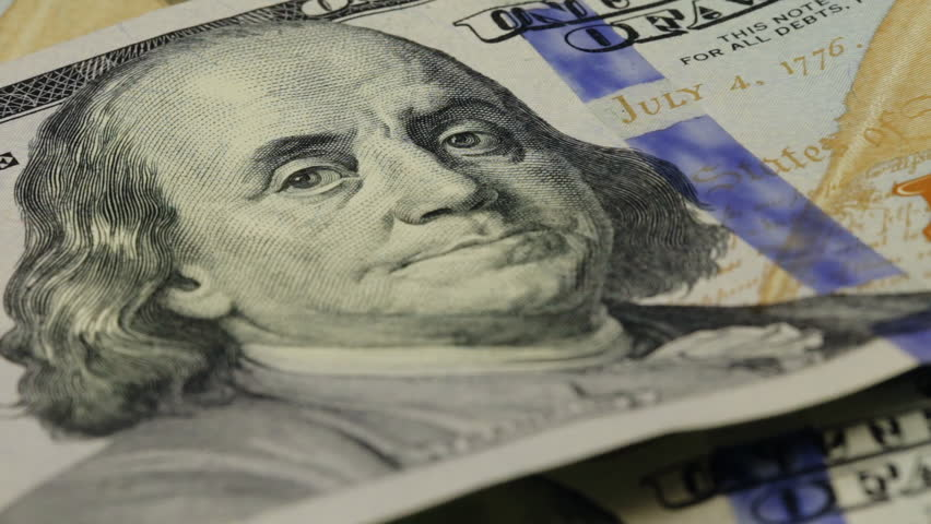 Cash money background. Benjamin Franklin portrait on 100 US dollar bill close up, the image is rotated   Shutterstock HD Video #15170089