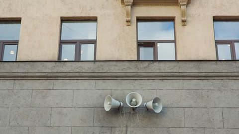 Vintage horn speaker on the wall of the old building