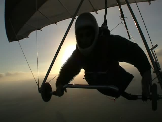 Hang glider pilot in silhoutte