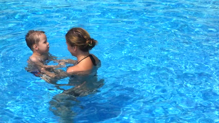 Mother with her son in the pool | Shutterstock HD Video #15187159