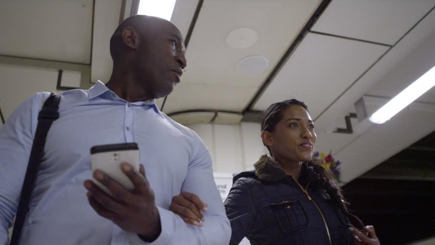 4k, happy African american tourists walking through subway underground station | Shutterstock HD Video #15194530