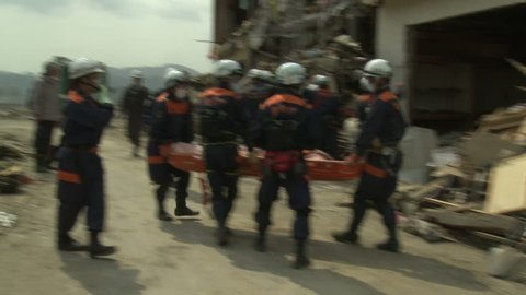 RIKUZENTAKATA, JAPAN - MARCH 2011: Japan Tsunami Aftermath - Rescue Team Attend To Dead Body In Rikuzentakata City - Full HD 1920x1080 30p.