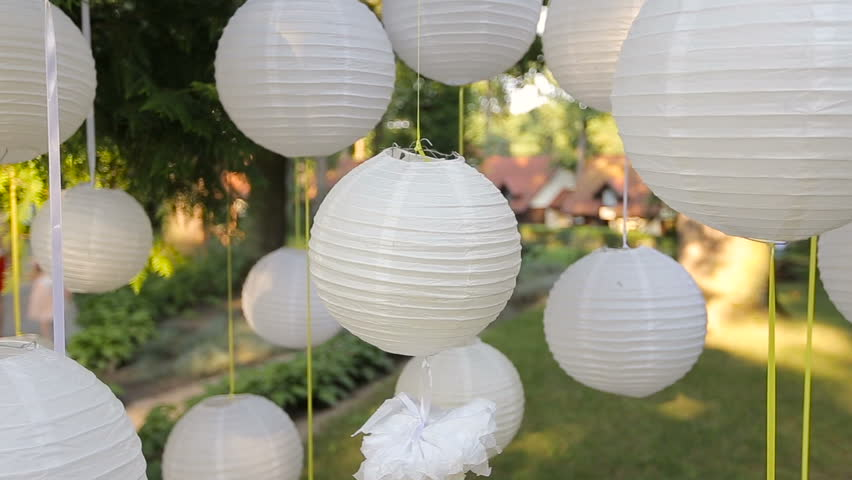 Closeup Beautiful Decor For A Party Of White Paper Chinese Lanterns Hanging In Tree