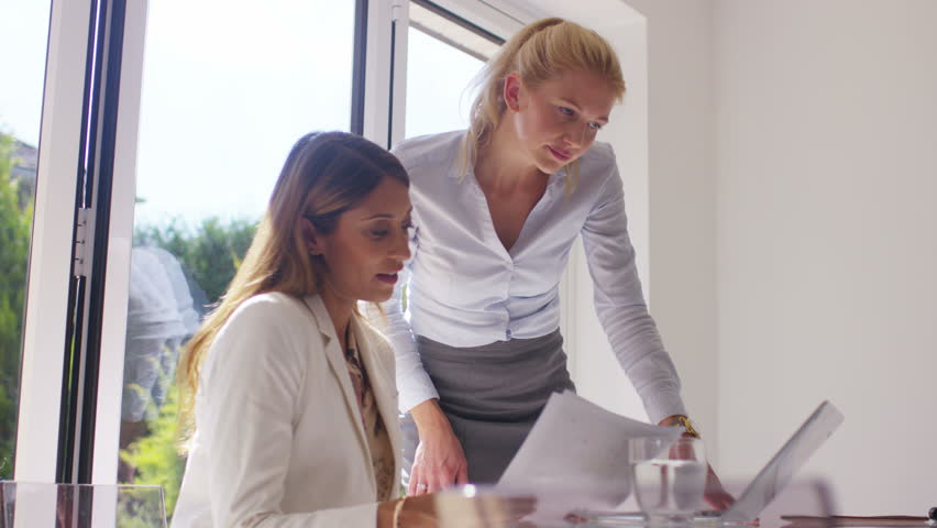 4K Attractive businesswomen working together in light modern office | Shutterstock HD Video #15216829