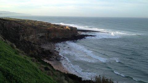 Ribeira d'Ilhas beach on the portuguese Atlantic coast. Beach and rocks of Ericeira.