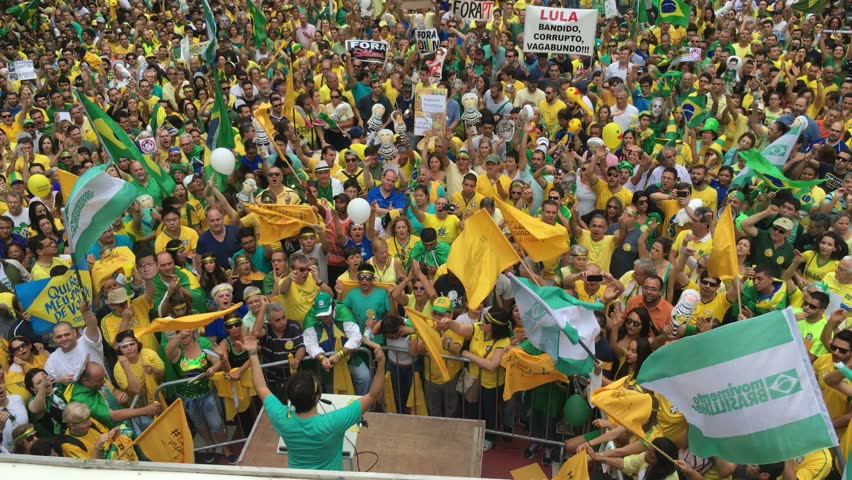 SAO PAULO, BRAZIL - MARCH 13, 2015: Large crowds of people protesting against Brazilian corruption and wanting the impeachment of president Dilma Rousseff and the removal of her political party PT. 4K