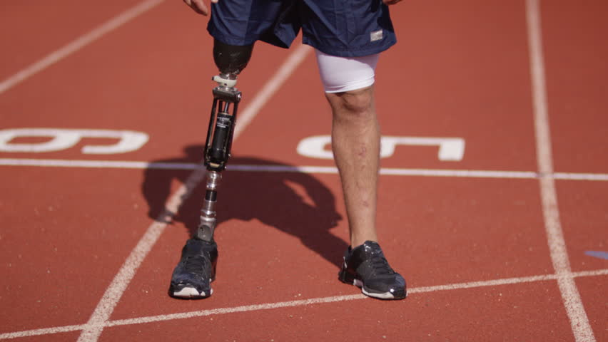 4K Portrait of smiling disabled athlete with prosthetic leg