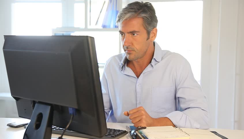 Office worker in front of desktop computer