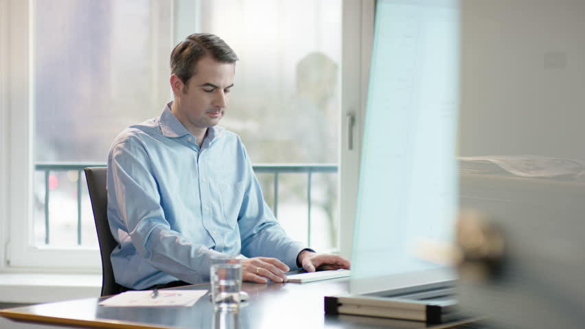 Business man at office desk making the right descision | Shutterstock HD Video #15255289