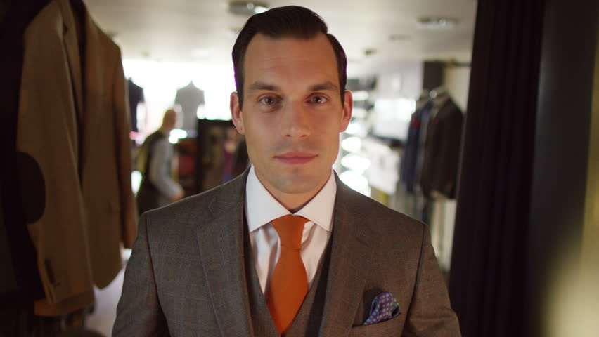 4K Handsome man trying on a new suit in tailor's shop