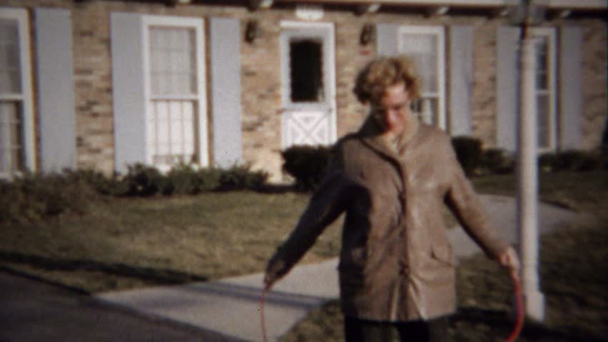 MOLINE, ILLINOIS 1963: Mother jumping rope attempt embarassingly fails quickly. | Shutterstock HD Video #15288739