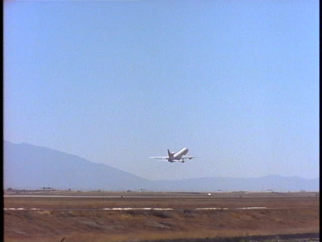 SALT LAKE CITY, UT - CIRCA 1997: A passenger plane takes off from an airport circa 1997 in Salt Lake, UT.