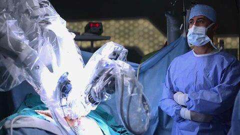 ISTANBUL, TURKEY, February, 2016: Medical robot. Robotic Surgery. Manipulators performing surgery on a man - Stock Footage