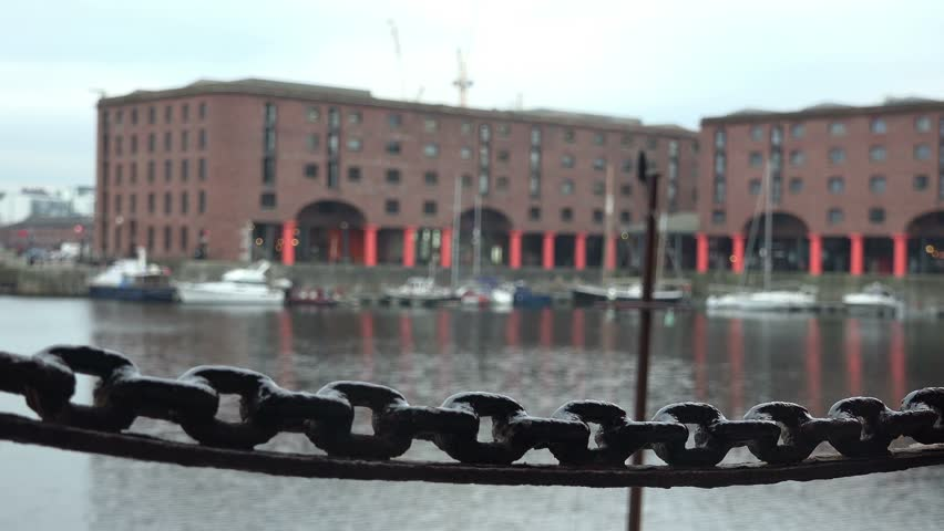 Albert docks in Liverpool, focus pull on chain in foreground The Albert Dock is a complex of Victorian dock buildings and warehouses in Liverpool, England. march 18th 2016