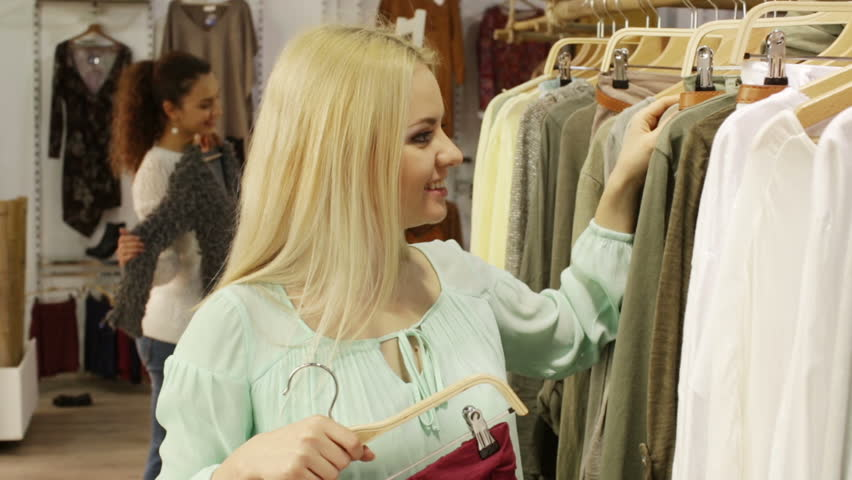 7eac42be30550 hd00:08Smiling young women shopping at the clothing store