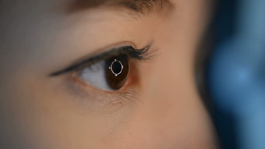Close up woman's eyes with eye test machine in ophthalmologist.  | Shutterstock HD Video #15341248