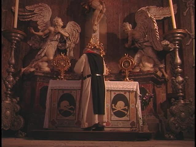 CZECH REPUBLIC - CIRCA 2006: A Catholic priest says a prayer in a church circa 2006 in Czech Republic.