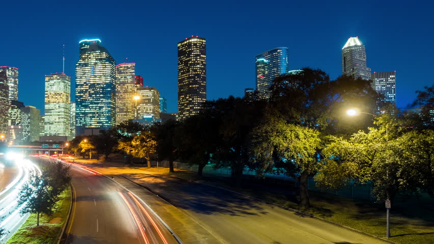 HOUSTON - 14 FEB: Dolly left timelapse view of the Houston City skyline at dusk with traffic moving at night, on 14 Feb 2015 in Houston, Texas, USA