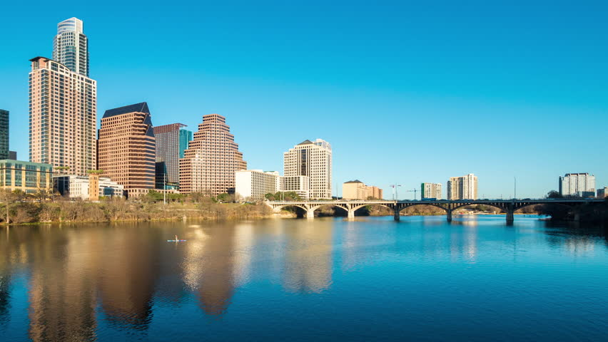 AUSTIN - 13 FEB: Dolly left timelapse view of the Austin City skyline at dusk with the river in the foreground, on 14 Feb 2015 in Austin, Texas, USA