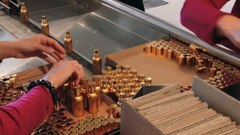 GRASSE, FRANCE - APRIL 10, 2014: Unidentified people pack bottles with perfume at the Fragonard perfume factory in Grasse, France.