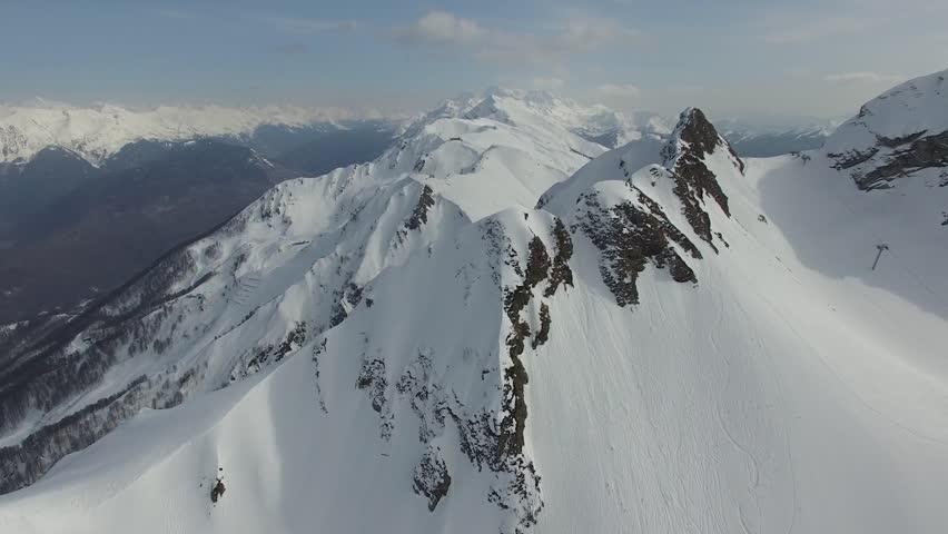 Flight over the snow mountain in Sochi | Shutterstock HD Video #15411169
