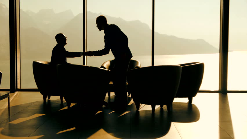 Business meeting of two professionals in modern lobby lounge at sunset. panoramic window view background | Shutterstock HD Video #15415579