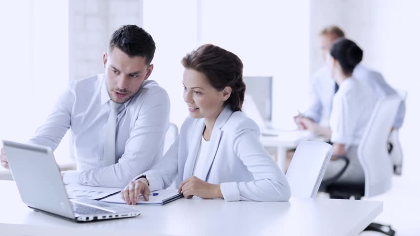 Group of business people having a meeting | Shutterstock HD Video #15422809