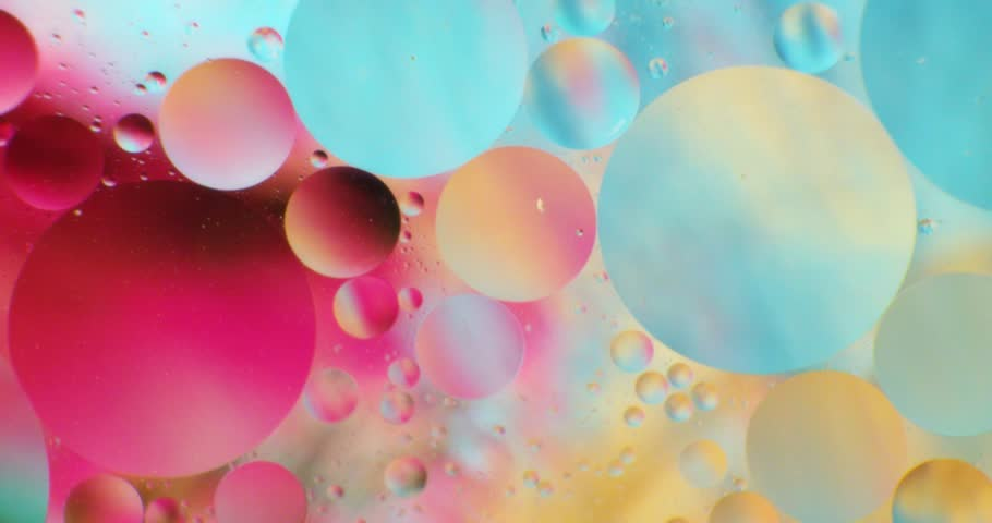 Color drops floating in oil and water over a colorful underground with oil painting effect.