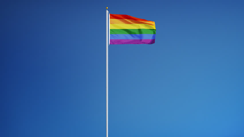 Slow Motion Of Rainbow Flag Waving Against Blue Sky Commonly The Gay Pride Flag And -3285