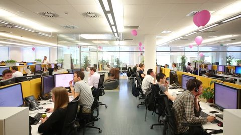 MOSCOW - JUN 03, 2015: Staff works in Tinkoff Bank office. Tinkoff Bank - only full online bank in Russia