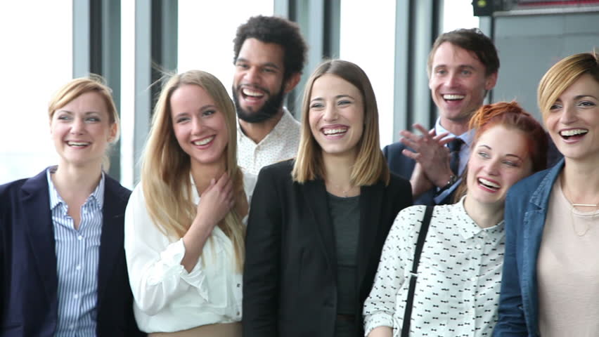 Close up of happy business people, laughing and clapping in office | Shutterstock HD Video #15442519