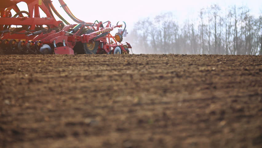 Agricultural tractor sowing and cultivating field in sunset. | Shutterstock HD Video #15452239
