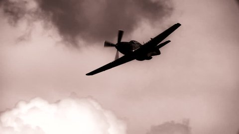 WWII P-51 Mustang Fighter flying in slow motion.  B&W.