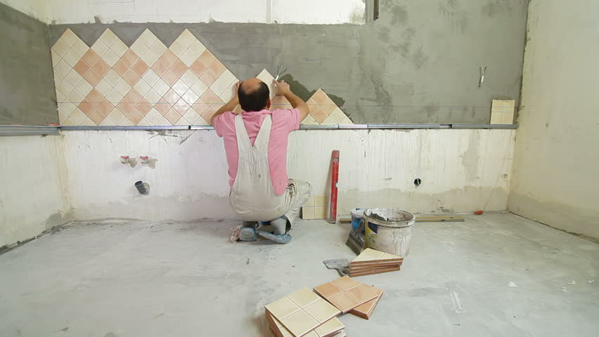 Worker Installing Tiles To A Kitchen Wall, Wide Angle Stock Footage ...