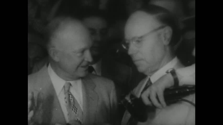 UNITED STATES 1950s: Dwight D Eisenhower waving / Eisenhower waves to crowd / Eisenhower in car in parade / Eisenhower speaks into microphone.