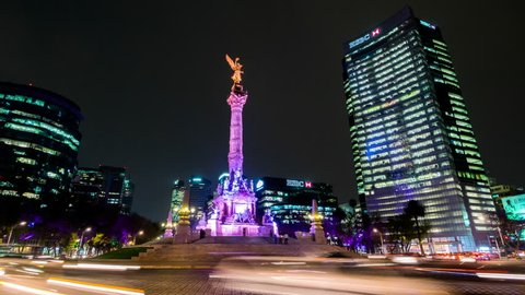 MEXICO CITY - 1 MAR: The Angel of Independence and Paseo de la Reforma timelapse view in Mexico city by night on 1 March 2014 in Mexico City, Mexico