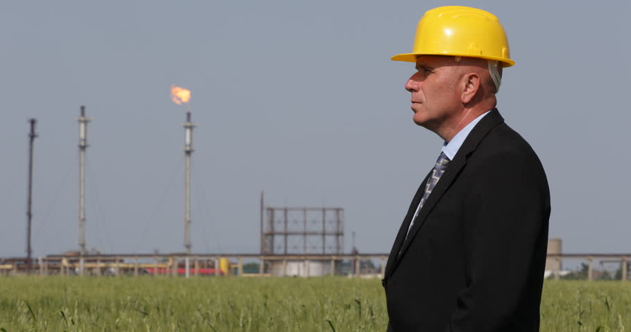 Business man looking petrochemical plant blueprint studying industrial petroleum serious businessman looking around oil processing factory ultra high definition ultrahd malvernweather Images