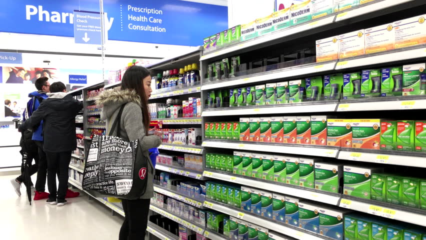 Coquitlam, BC, Canada - March 23, 2016 : People taking medicine at pharmacy section inside Walmart store with 4k resolution
