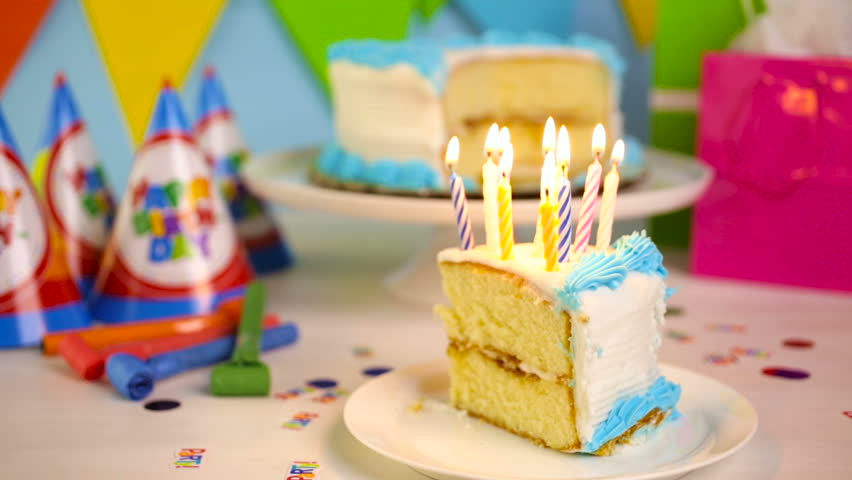Simple White Birthday Cake Slice With White And Blue Icing Stock